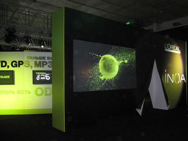 эксклюзивный выставочный стенд, выставочный стенд для компании loreal inoa, выставочный стенд с видео стеной, застройка выставочного стенда, уникальный стенд на выставку